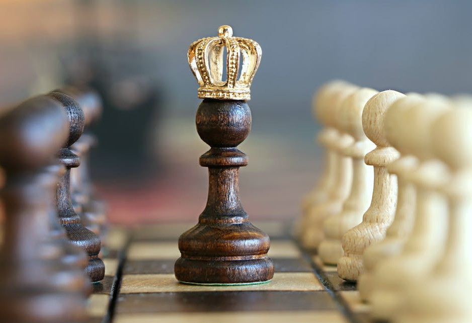 king on chessboard with golden crown