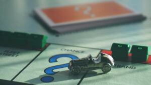 monopoly board with car on chance space