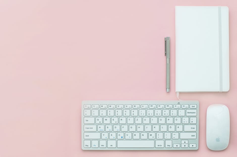simple white keyboard and notebook