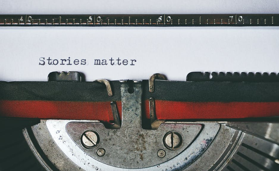 old typewriter with the words stories matter typed on it